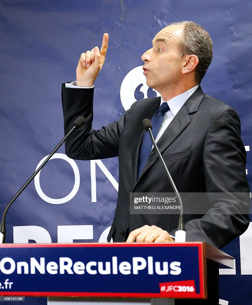 French member of parliament candidate in the right-wing opposition Les Republicains (LR) party primary ahead of France's 2017 presidential elections, Jean-Francois Cope, gestures as he delivers a speech during the inauguration of his election campaign headquarters, on May 31, 2016, in Paris. / AFP / MATTHIEU