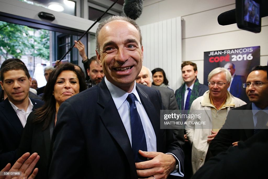 French member of parliament candidate in the right-wing opposition Les Republicains (LR) party primary ahead of France's 2017 presidential elections, Jean-Francois Cope, arrives for the inauguration of his election campaign headquarters, on May 31, 2016, in Paris. / AFP / MATTHIEU