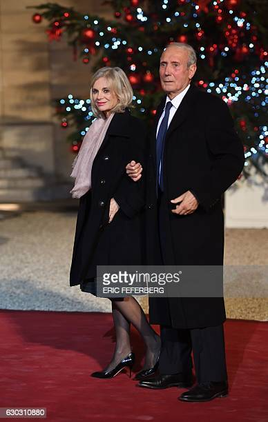 French member of Parliament Elisabeth Guigou and her husband JeanLouis arrive for a state diner with French and Senegal Presidents on December 20...