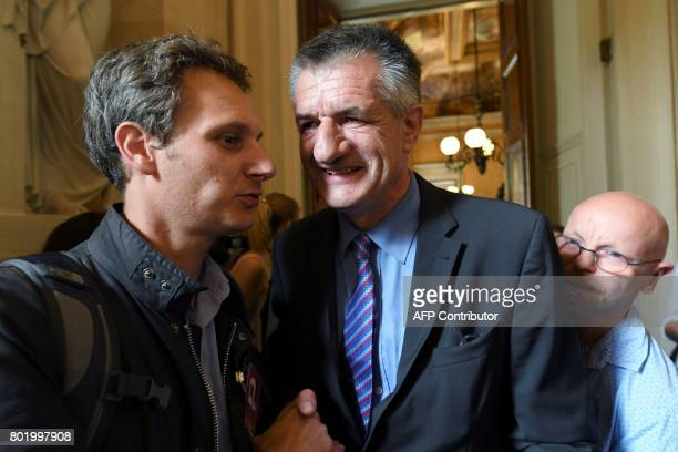 French Member of Parliament Jean Lassalle smiles during the inaugural session of the 15th legislature of the French Fifth Republic at the National...