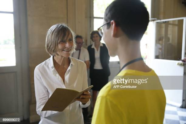 French member of Parliament of MoDem centrist party Marielle de Sarnez signs an autograph as she arrives at the French National Assembly in Paris on...