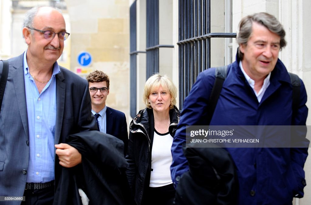 French member of the European parliament Nadine Morano (2ndR) arrives with her lawyers Alain Behr (R) and Antoine Fittante (L) at the courthouse of Nancy for the trial in appeal process of French humorist Guy Bedos in a libel suit on May 24, 2016. Bedos called Morano a 'bitch' during a show in Toul, northeastern France in 2013. / AFP / JEAN