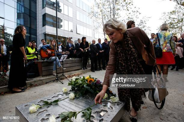 French member of the European parliament Nadine Morano lays a white rose during a ceremony in support of victims of terrorism and emergency response...