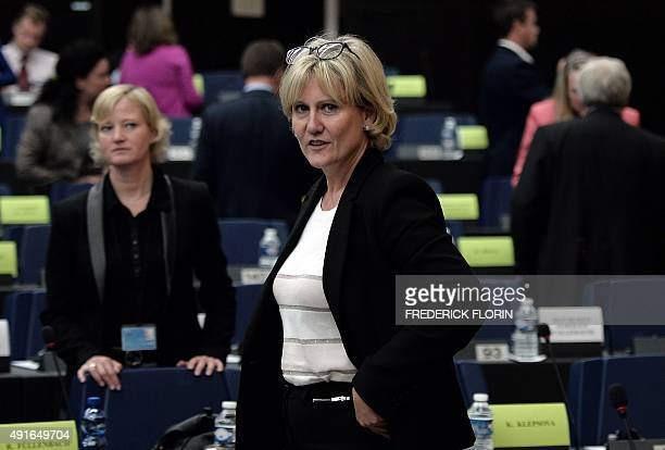 French member of the European parliament Nadine Morano prepares to take her seat as she arrives to attend a meeting with German Chancellor Angela...