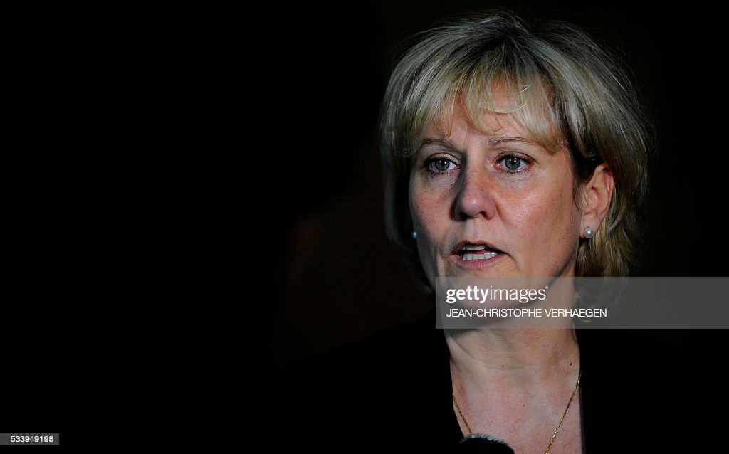 French member of the European parliament Nadine Morano speaks to journalist at Nancy's courthouse, on May 24, 2016, after a hearing of the appeal trial of French humorist Guy Bedos, against whom Morano filed a complaint for public insult after he called her a 'bitch' during a show in 2013. / AFP / JEAN