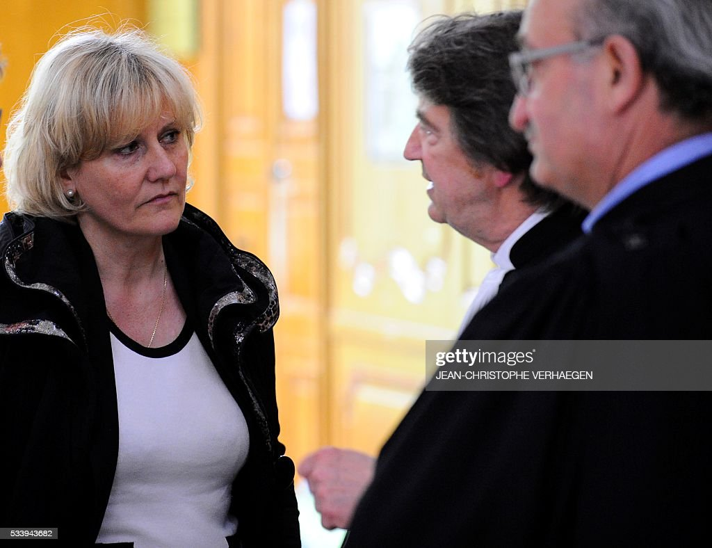 French member of the European parliament Nadine Morano (L) speaks with her lawyers Alain Behr (C) and Antoine Fittante (R), at the courthouse of Nancy for the trial in appeal process of French humorist Guy Bedos in a libel suit on May 24, 2016. Bedos called Morano a 'bitch' during a show in Toul, northeastern France in 2013. / AFP / JEAN
