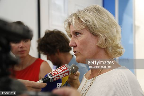 French member of the right wing party 'Les Republicains' Nadine Morano speaks to journalists as she arrives at the opposition rightwing 'Les...