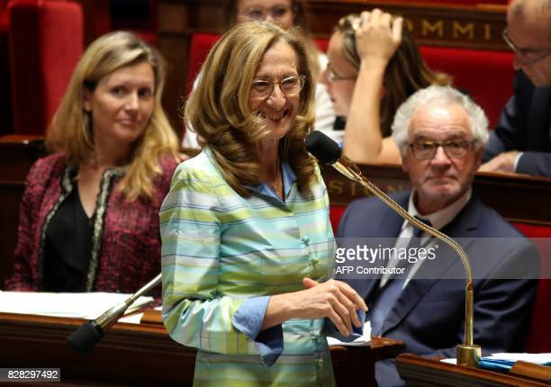 French Members of Parliament Yaël BraunPivet and Didier Paris look on as French Justice Minister Nicole Belloubet addresses The National Assembly in...