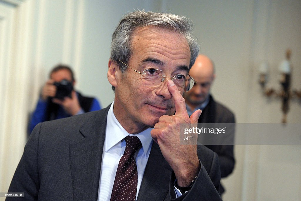 French Metal Industries Federation (UIMM) Chairman Frederic Saint-Geours adjusts his glasses as he leaves a press conference on April 5, 2013 in Paris after announcing his candidacy to French Employers association Medef's presidency.