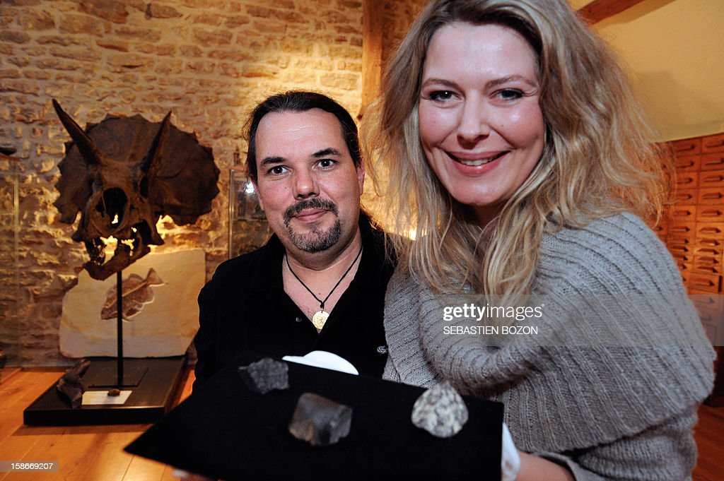 French meteorite seekers Carine Bidaut (R) and Bruno Fectay (L) pose with three fragments of meteorites from Mars, in Poligny, eastern France, on November 12, 2012.