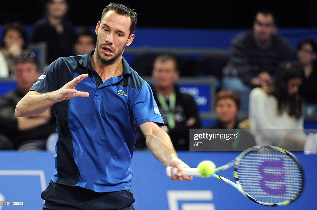 French Michael Llodra returns the ball to his opponent French Benoit Paire during the Open Sud de France world tour ATP Series semi final tennis match, on February 9, 2013 in Montpellier, southern France. Paire won 4-6, 6-3, 6-1.