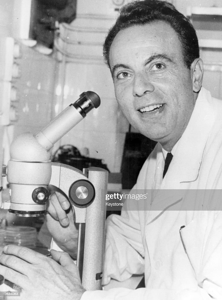French microchemist Professor Francois Jacob, joint winner of the 1965 Nobel prize for physiology or medicine, using a microscope.
