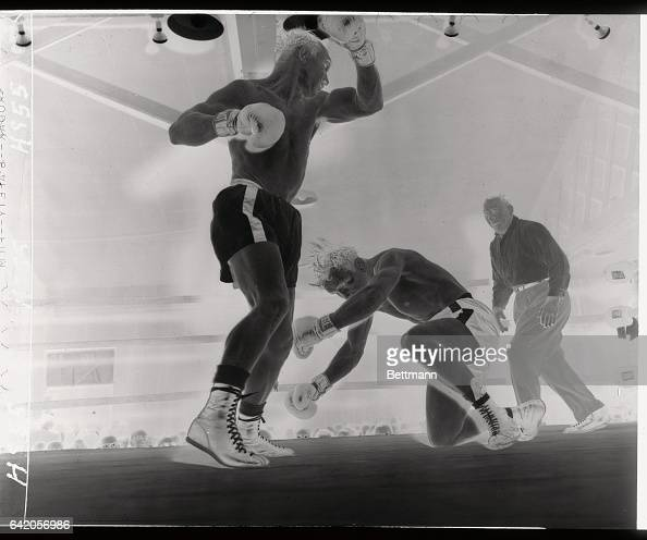French middleweight Marcel Assire slips to the canvas in the ninth round of his bout with Gene Fullmer of Utah at the Eastern parkway Arena Ref Al...