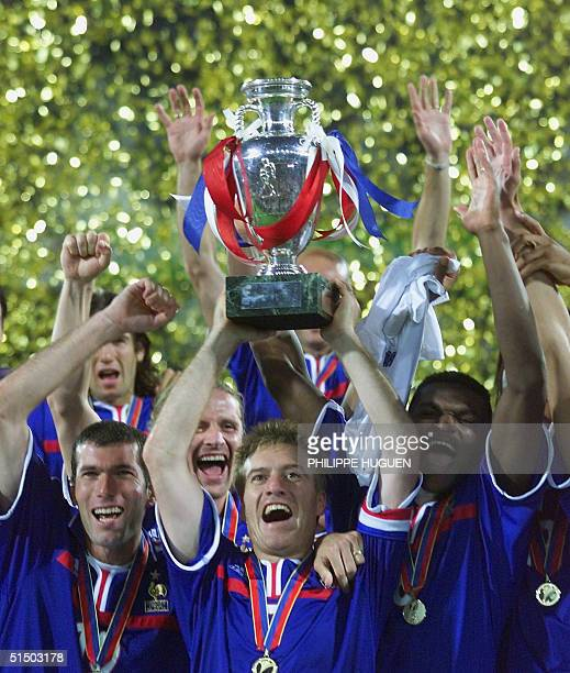 French midfielder and captain Didier Deschamps holds up the Euro2000 soccer championships trophy after France won the final against Italy 21 on a...