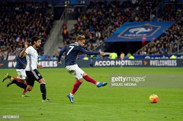French midfielder Antoine Griezmann shoots during a friendly international football match between France and Germany ahead of the Euro 2016 on...