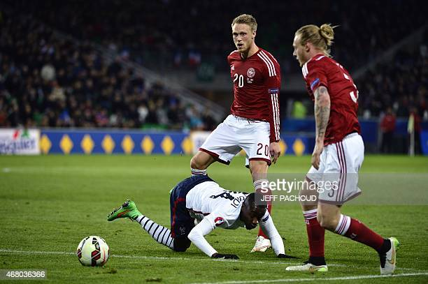 French midfielder Blaise Matuidi is tackled by Denmark's forward Nicolai Jorgensen during the friendly football match France vs Denmark on March 29...
