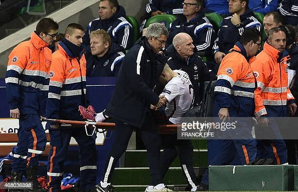 French midfielder Christophe Jallet leaves a field after injury during the friendly football match France vs Denmark on March 29 2015 at the...