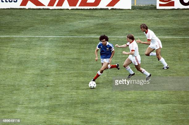 French midfielder Michel Platini vies with Czechoslovakia's players during the 1982 World Cup football match between Czechoslovakia and France on...