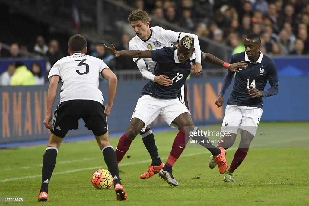 French midfielder Paul Pogba vies with Germany's midfielder Thomas Muller during a friendly international football match between France and Germany...