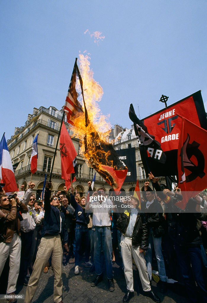 French militants burn an American flag during the Fete de Jeanne d'Arc, or Festival of Joan of Arc. Members of French right-wing political groups, including Front National leader Jean-Marie Le Pen, attended the annual festival.