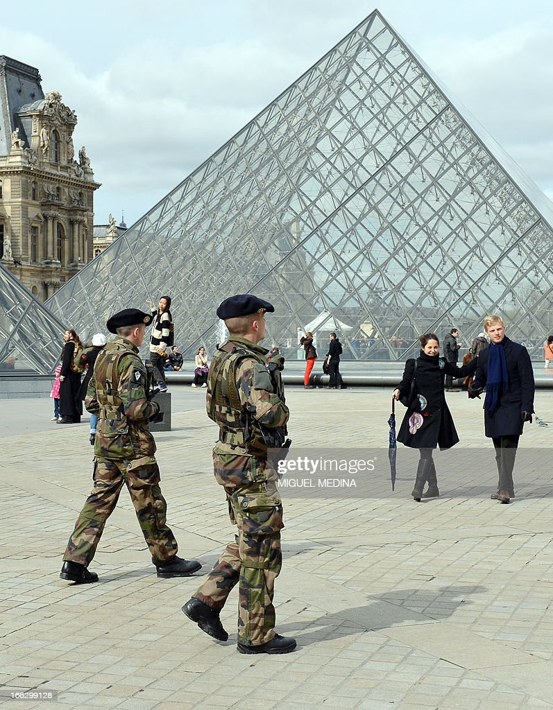 French militaries patrol on April 11, 2013 at the 'Cour Carree' of the Louvre Museum in Paris. Paris's Louvre museum today reopened its doors to the public after a walkout by some staff in protest at gangs of pickpockets operating at the world famous art gallery. Around 20 police officers have now been drafted in to patrol the museum in response to staff concerns, Louvre officials told AFP. The day before, the Louvre failed to open when around 200 employees refused to work saying the museum had become plagued by gangs of increasingly aggressive pickpockets, many of whom were children.
