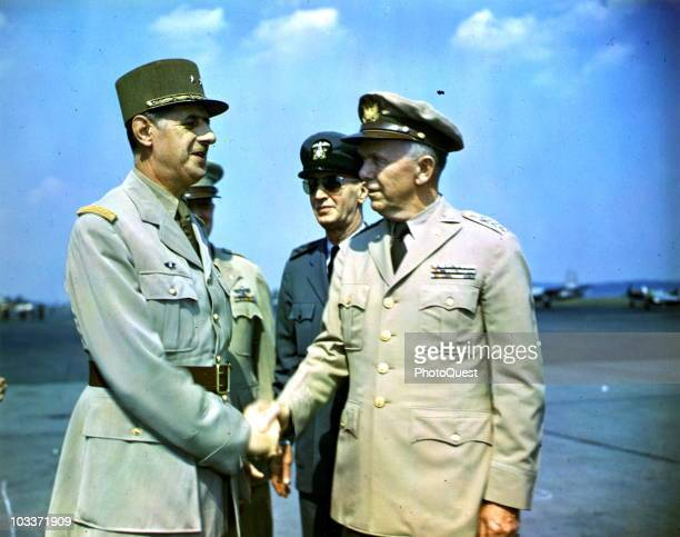 French military commander and head of the French Provisional Government Charles de Gaulle shakes hands with is greeted by American Chief of Staff...