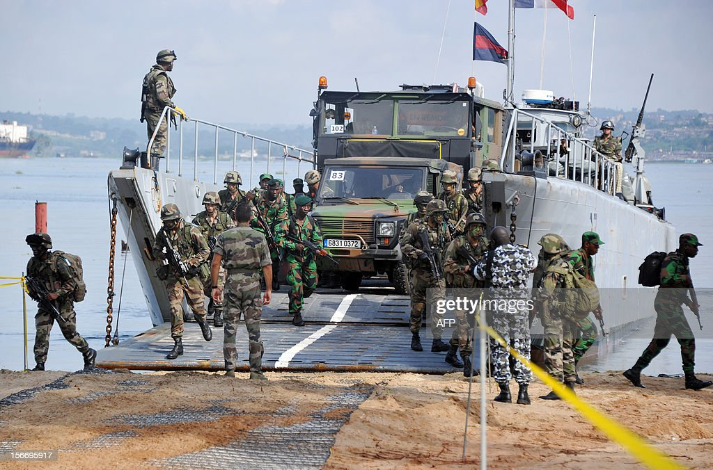 French military forces based in Gabon and Ivorian military forces disembark a boat during a mock exercise named akwaba aiming at strenghtening Ivorian army , on November 19, 2012 in Abidjan.