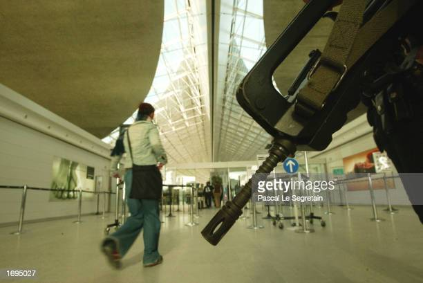 French military soldier stands guard inside Terminal Two of Charles De Gaulle airport December 19 2002 in Roissy France The French government has...