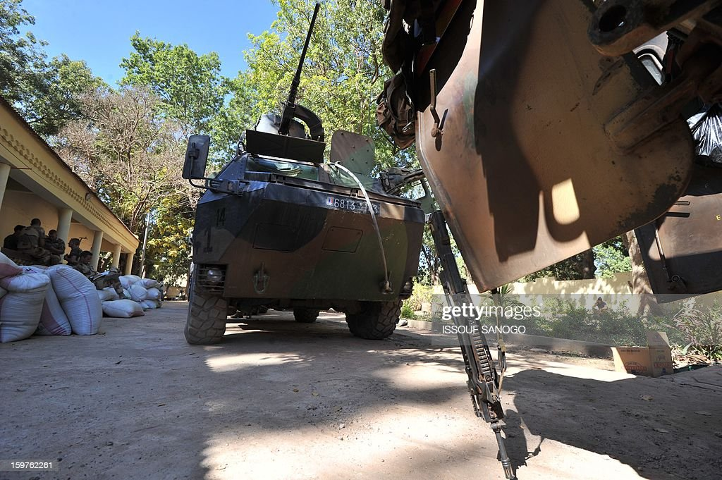 French military vehicles are seen on January 20, 2013 in the city of Niono, about 350 kms (220 miles) northeast of the capital Bamako and 60 kms south of Diabaly, which was seized on January 14 by Islamists and then heavily bombed by French warplanes. A spokesman for the French military operation codenamed Serval said on January 20 that French forces were advancing towards Mali's Islamist-held north after taking up positions in the towns of Niono and Sevare. AFP PHOTO / ISSOUF SANOGO