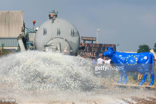 French milk farmers spray milk in a field near by a Lactalis milk group factory on September 21 2009 in IsignyleBuat northern France during a protest...