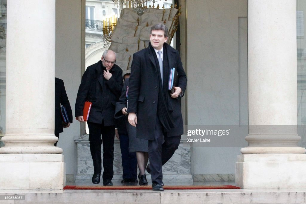 French Minister <a gi-track='captionPersonalityLinkClicked' href=/galleries/search?phrase=Arnaud+Montebourg&family=editorial&specificpeople=588268 ng-click='$event.stopPropagation()'>Arnaud Montebourg</a> departs the French Cabinet Meeting at Elysee Palace on January 30, 2013 in Paris, France.
