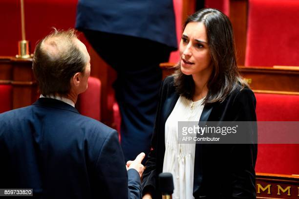 French Minister attached to the Minister of Ecological and Inclusive Transition Brune Poirson speaks with a MP as she attends a session of questions...