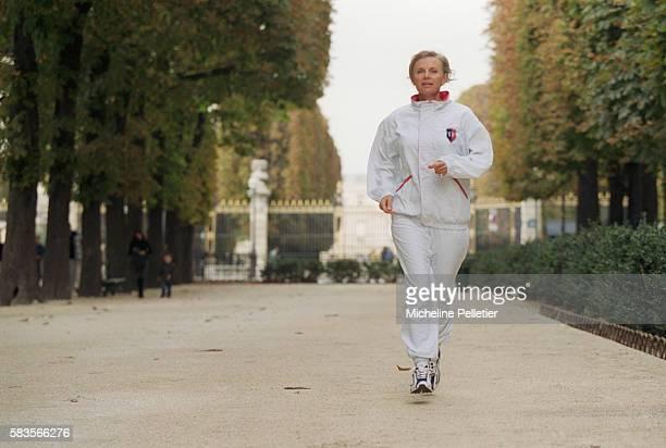French Minister Elisabeth Guigou Jogging in the Park