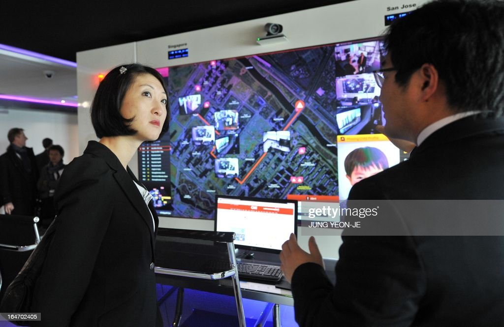 French Minister Fleur Pellerin (L) visits the Cisco u-technology model room at the Songdo International Business District in Incheon, west of Seoul, on March 27, 2013. Pellerin, the junior minister for small and medium enterprises, innovation and the digital economy, began a highly anticipated visit on March 23 to South Korea, the land of her birth, where her unusual success story is a source of public pride, admiration and curiosity. AFP PHOTO / JUNG YEON-JE