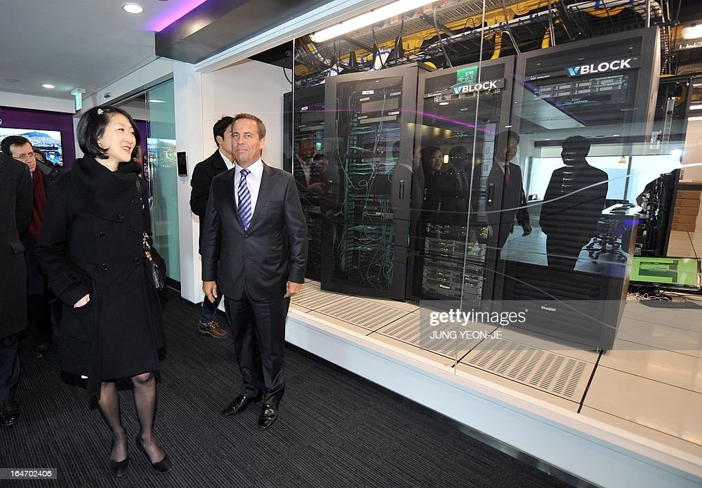 French Minister Fleur Pellerin (L) visits the Cisco u-technology model room at the Songdo International Business District in Incheon, west of Seoul, on March 27, 2013. Pellerin, the junior minister for small and medium enterprises, innovation and the digital economy, began a highly anticipated visit on March 23 to South Korea, the land of her birth, where her unusual success story is a source of public pride, admiration and curiosity.