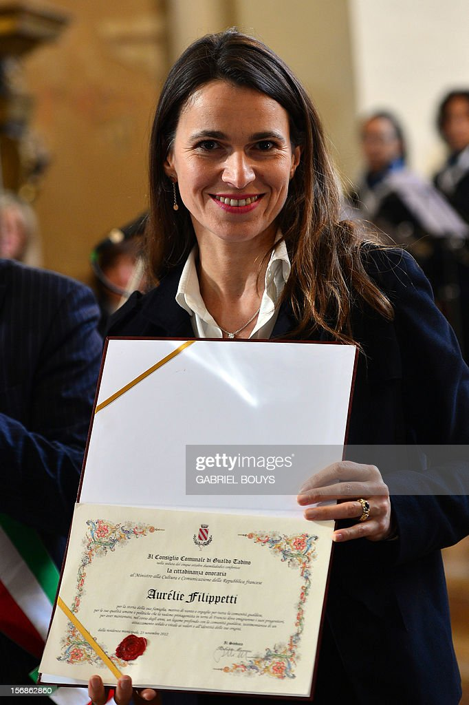 French Minister for Culture and Communication, Aurelie Filippetti poses with a certificate in Gualdo Tadino, on November 23, 2012, after being awarded as Citizen of Honor during a ceremony in honor of her grand-father born in this village in Umbria. Her grand-father, Tommaso, was an anti-fascist Italian who migrated to France and died in the Bergen-Belsen concentration camp in 1945.