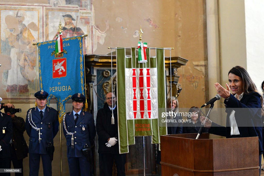 French Minister for Culture and Communication, Aurelie Filippetti (R) delivers a speech during a ceremony in Gualdo Tadino, on November 23, 2012, in honor of her grand-father born in this village in Umbria. Her grand-father, Tommaso, was an anti-fascist Italian who migrated to France and died in the Bergen-Belsen concentration camp in 1945. Aurelie Filippetti was honored as Citizen of Honor of Gualdo Tadino as part of this ceremony.