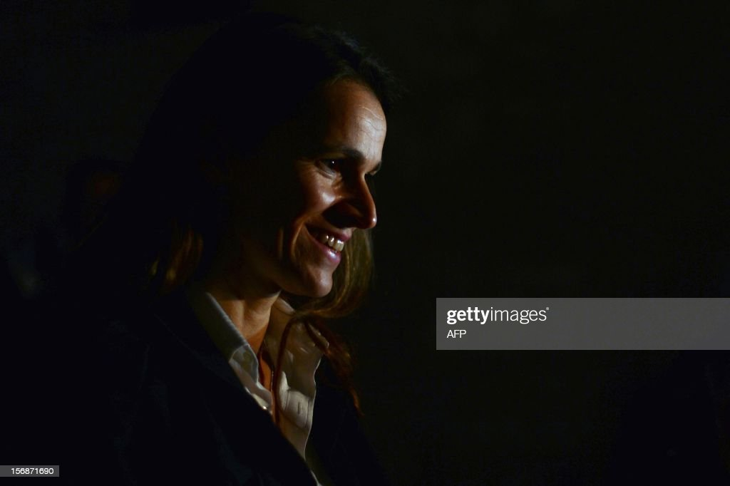 French Minister for Culture and Communication, Aurelie Filippetti, smiles as she visits the Basilica of San Francesco d'Assisi (Saint Francis) in Assisi on November 23, 2012, during a two-day official visit to Italy.