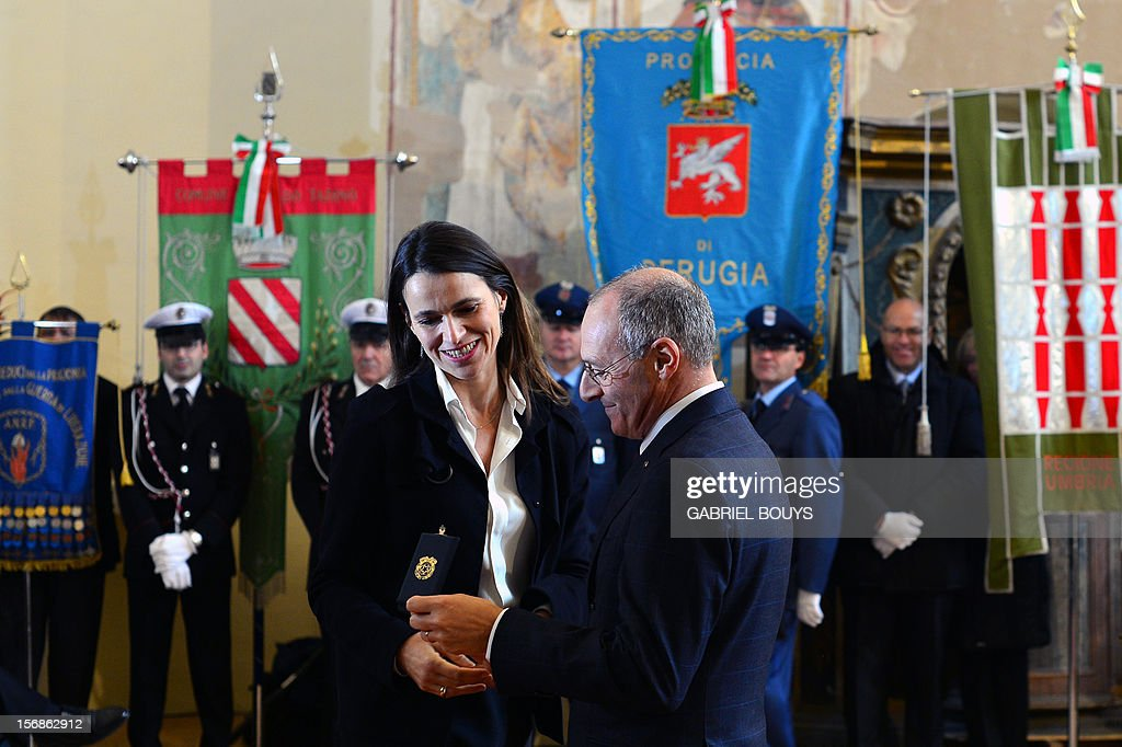 French Minister for Culture and Communication, Aurelie Filippetti (L) is honored as Citizen of Honor of Gualdo Tadino during a ceremony in Gualdo Tadino, on November 23, 2012, in honor of her grand-father born in this village in Umbria. Her grand-father, Tommaso, was an anti-fascist Italian who migrated to France and died in the Bergen-Belsen concentration camp in 1945.