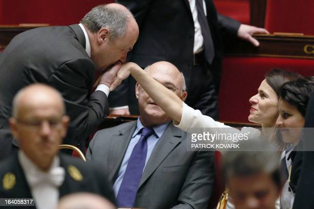 French Minister for Culture and Communication Aurelie Filippetti is handkissed by French deputy president of the Socialist group at the national...
