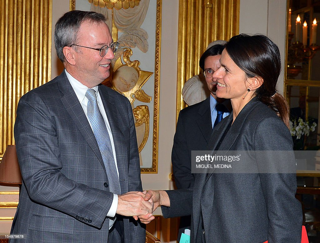 French Minister for Culture and Communication, Aurelie Filippetti (R) shakes hands with US Internet giant Google executive chairman Eric Schmidt (L) prior to a meeting, on October 29, 2012 at the Ministry of Culture in Paris. Google's executive chairman Schmidt will meet with French President Francois Hollande later in the day, as the Internet giant wrangles with Paris over a bill that would force search engines to pay for content, a government source said on October 27. Google had warned that it would exclude French media sites from its search results if France adopted a bill that would force search engines to pay for content.
