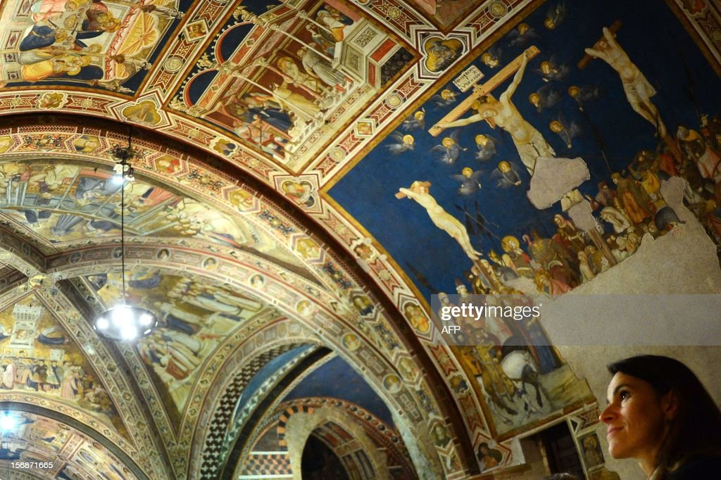 French Minister for Culture and Communication, Aurelie Filippetti, visits the Basilica of San Francesco d'Assisi (Saint Francis) in Assisi on November 23, 2012, during a two-day official visit to Italy. AFP PHOTO / GABRIEL BOUYS