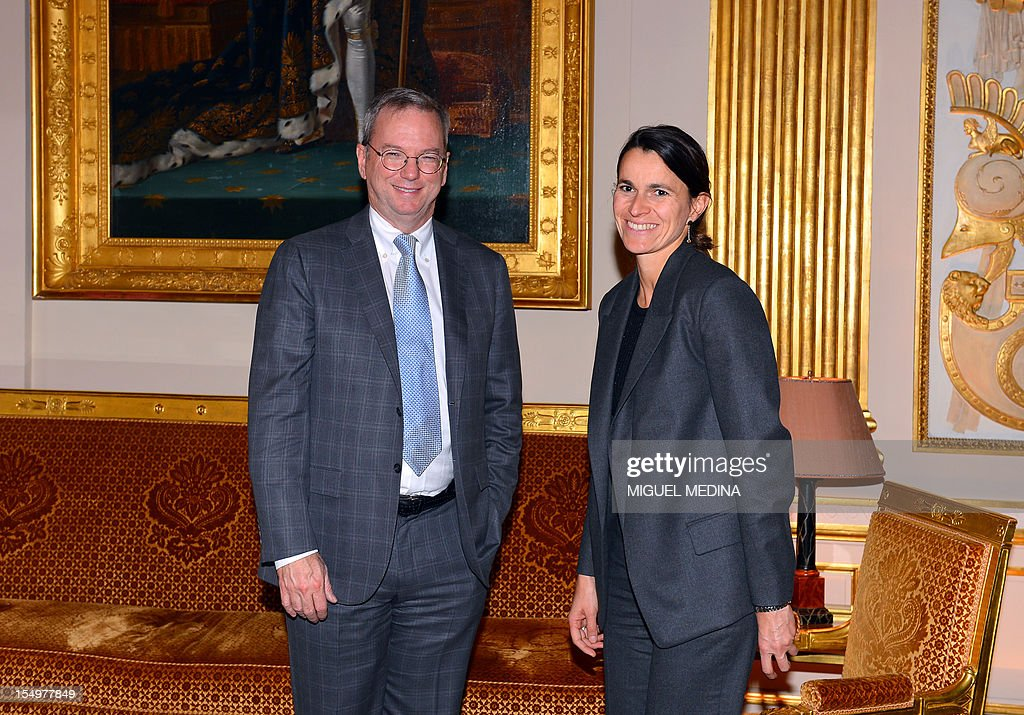 French Minister for Culture and Communication, Aurelie Filippetti (R) poses with US Internet giant Google executive chairman Eric Schmidt (L) prior to a meeting, on October 29, 2012 at the Ministry of Culture in Paris. Google's executive chairman Schmidt will meet with French President Francois Hollande later in the day, as the Internet giant wrangles with Paris over a bill that would force search engines to pay for content, a government source said on October 27. Google had warned that it would exclude French media sites from its search results if France adopted a bill that would force search engines to pay for content.