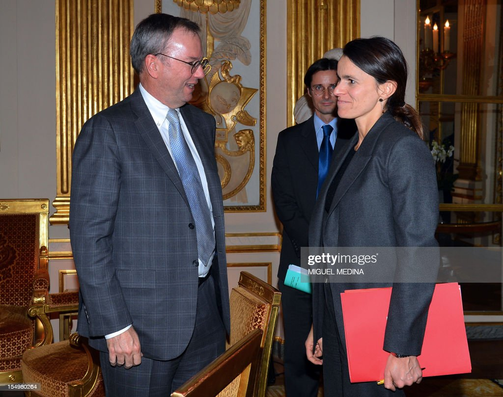 French Minister for Culture and Communication, Aurelie Filippetti (R) welcomes US Internet giant Google executive chairman Eric Schmidt (L) prior to a meeting, on October 29, 2012 at the Ministry of Culture in Paris. Google's executive chairman Schmidt will meet with French President Francois Hollande later in the day, as the Internet giant wrangles with Paris over a bill that would force search engines to pay for content, a government source said on October 27. Google had warned that it would exclude French media sites from its search results if France adopted a bill that would force search engines to pay for content.