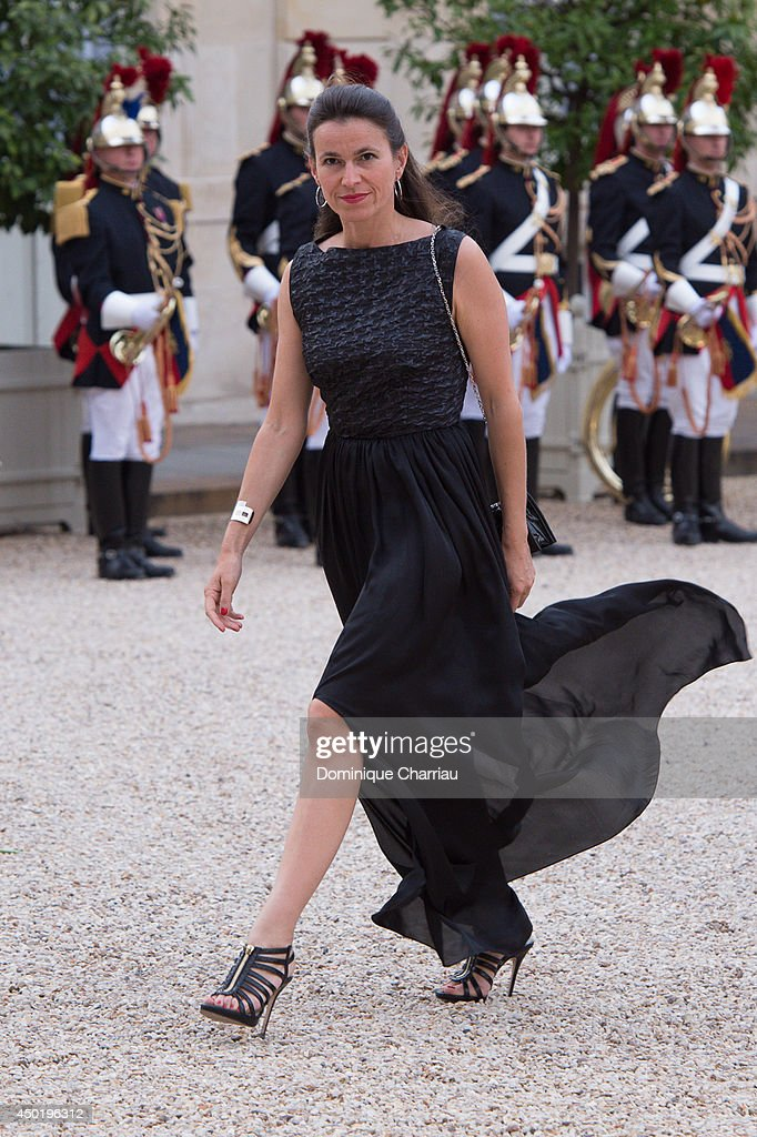 French Minister for Culture Aurelie Filippetti arrives at the Elysee Palace for a State dinner in honor of Queen Elizabeth II, hosted by French President Francois Hollande as part of a three days State visit of Queen Elizabeth II after the 70th Anniversary Of The D-Day on June 6, 2014 in Paris, France.