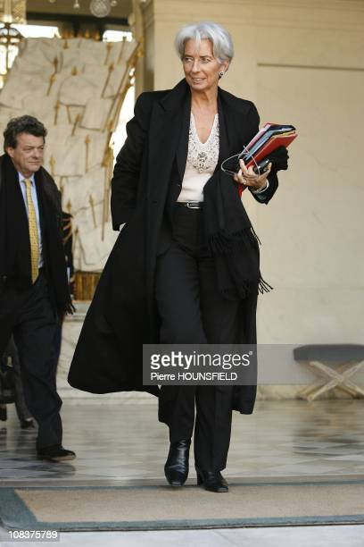 French Minister for Ecology JeanLouis Borloo and French Minister for Economy Finance and Employment Chrsitine Lagarde leave the weekly cabinet...