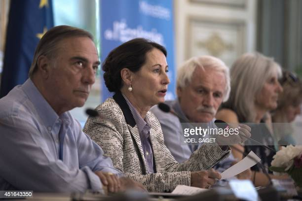 French minister for Ecology Sustainable Development and Energy Segolene Royal speaks next to Representative of French nongovernmental organizations...