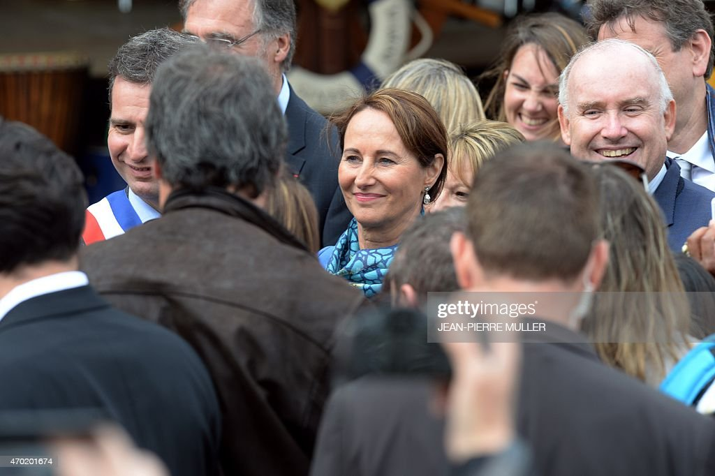 French Minister for Ecology, Sustainable Development and Energy Segolene Royal (C), flanked by Former French Minister of Transportation <a gi-track='captionPersonalityLinkClicked' href=/galleries/search?phrase=Dominique+Bussereau&family=editorial&specificpeople=722874 ng-click='$event.stopPropagation()'>Dominique Bussereau</a> (R), greets peolpe in Fouras, southwestern France, on April 18, 2015, after visiting the replica of the French navy frigate L'Hermione, which played a key role in the American Revolution, and which will set sail on its maiden voyage to the United States. The replica of the French navy frigate Hermione which brought General Lafayette to America to rally rebels fighting Britain in the US war of independence, will set sail for the United States again, 235 years after the original crossing. L'Hermione will leave its mooring on the island of Aix in the west of France, navigate up the Charente river to the naval town of Rochefort to pay homage to its birthplace, and finally head back to Aix before heading West.