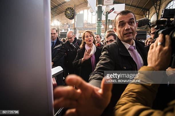 French minister for Ecology Sustainable Development and Energy Segolene Royal gestures towards journalist upon arrival to the Gare Du Nord's railway...