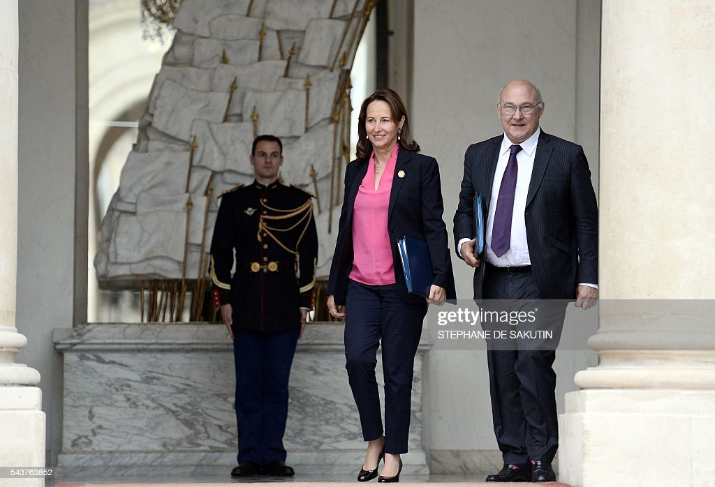 French minister for Ecology, Sustainable Development and Energy Segolene Royal (L) and French Finance minister Michel Sapin leave after a weekly cabinet meeting on June 30, 2016 at the Elysee presidential Palace in Paris. / AFP / STEPHANE